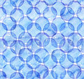 Seamless watercolor texture, based on blue hand drawn imperfect circles in a geometric repeating design. Square pattern, good for