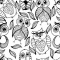 Seamless white and black pattern of four different owls