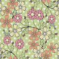 Seamless white flowers pattern specks background green Royalty Free Stock Image