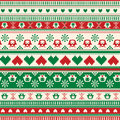 Seamless winter sweater pattern with hearts and owls red green version can be used for wallpaper fills Stock Photography