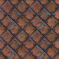 Seamless wooden panel door texture with nails Royalty Free Stock Photo