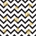 Seamless zigzag pattern. with gold circles and triangles. Seamless background with horizontal black stripes in zigzag