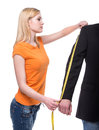 Seamstress beautiful young woman tailor designer stylist with measuring tape Stock Photos