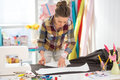 Seamstress making pattern on fabric in studio Royalty Free Stock Images