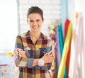 Seamstress with scissors and measuring tape portrait of happy Royalty Free Stock Photos