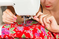 Seamstress sew fabric on the sewing machine. Royalty Free Stock Photo