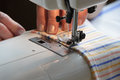 Seamstress sewing on a machine closeup Royalty Free Stock Photos