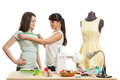 The seamstress takes measurements Royalty Free Stock Photo