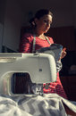 Seamstress woman during work with sewing machine Stock Photography