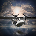 The seaplane old rescue flying against sunset over a sea level Royalty Free Stock Photo