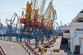 Seaport cranes a cargo container ships and is docked at the shipyard Royalty Free Stock Photography