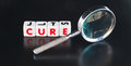 Searching for a cure text in uppercase red letters on small white cubes with hand magnifier dark background Stock Photography
