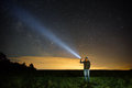 Searching with flashlight in outdoor Royalty Free Stock Photo