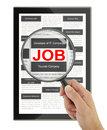 Searching for a job with a magnifying glass in digital tablet Stock Images