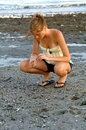 Searching for shells at low tide Royalty Free Stock Photo