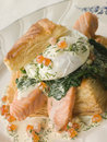 Seared Salmon Spinach and a Poached Egg Stock Images