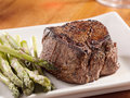 Seared tenderloin steak with asparagus. Royalty Free Stock Photo