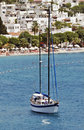 Seascape with anchored sailboat off the beach Royalty Free Stock Photography