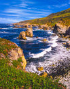 Seascape of big sur coastline surf shoreline route california with breaking waves in a rocky cove Royalty Free Stock Photos