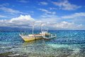 Seascape with boat. Apo island, Philippines Stock Photo