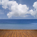 Seascape with clouds calm water and wooden planks Stock Images