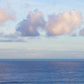 Seascape with deap blue ocean waters at sunrise beautiful deep and cloudscape Royalty Free Stock Photography