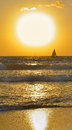 Seascape, little lonely sailboat and large disc of Royalty Free Stock Photo