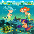 Seascape with mermaids and triton vector cartoon illustration Royalty Free Stock Image