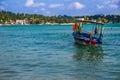 Seascape with motor boat, ceylon, unawatuna