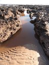 Seascape with sand ridges and rock pools photographed at sidmouth in devon Stock Photography