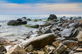Seascape scenic large stones against the sea and sky bright Stock Photography