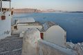 Seascape with White houses in town of Oia, Santorini island, Thira, Greece Royalty Free Stock Photo