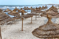 Seashore with parasols from palm leaf on Mediterranean Royalty Free Stock Photos