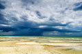 Seashore stormy sky and beach at low tide Royalty Free Stock Images