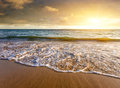 Seashore sunset beautiful in a beach with cloudy sky at Royalty Free Stock Images