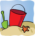 Seaside beachbucket Stock Photos