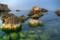 Seaside landscape with rocks great some transparent water and blue cold and fresh colors Stock Photo