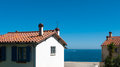 Seaside resort view of the typical mediterranean buildings on the Stock Photos