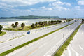 Seaside roadway that connecting to the island under blue sky Stock Photography