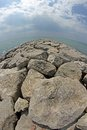 Seaside rocks and breakwaters photographed with the fisheye lens very picturesque Royalty Free Stock Photography