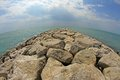 Seaside rocks and breakwaters picturesque photographed with the fisheye lens Royalty Free Stock Photos