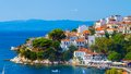 Seaside town with harbour and mountain in the background Royalty Free Stock Photos