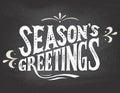 Season's greetings on chalkboard background Royalty Free Stock Photo