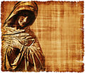 Season of sorrow an old worn parchment featuring the virgin mary in digital image created using a cemetery monument Royalty Free Stock Images