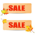 Seasonal autumn sale sheets of paper with the word decorated maple leaves announcement of the discounts on Royalty Free Stock Photography