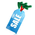 Seasonal christmas sale blue price tag with the word on a tree branch new year clearance Royalty Free Stock Photo