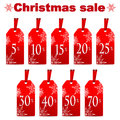 Seasonal christmas sale set of red price tags with percent discount isolated on white background new year clearance Stock Image