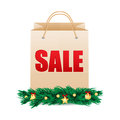 Seasonal christmas sale shopping bag with the word decorated with fir branches and decorations paper bag for Stock Images