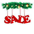 Seasonal christmas sale word decorated with tree branches branches of a tree with red tags on white Stock Photo