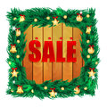 Seasonal christmas sale word on wooden boards in the frame of the decorations Stock Photo